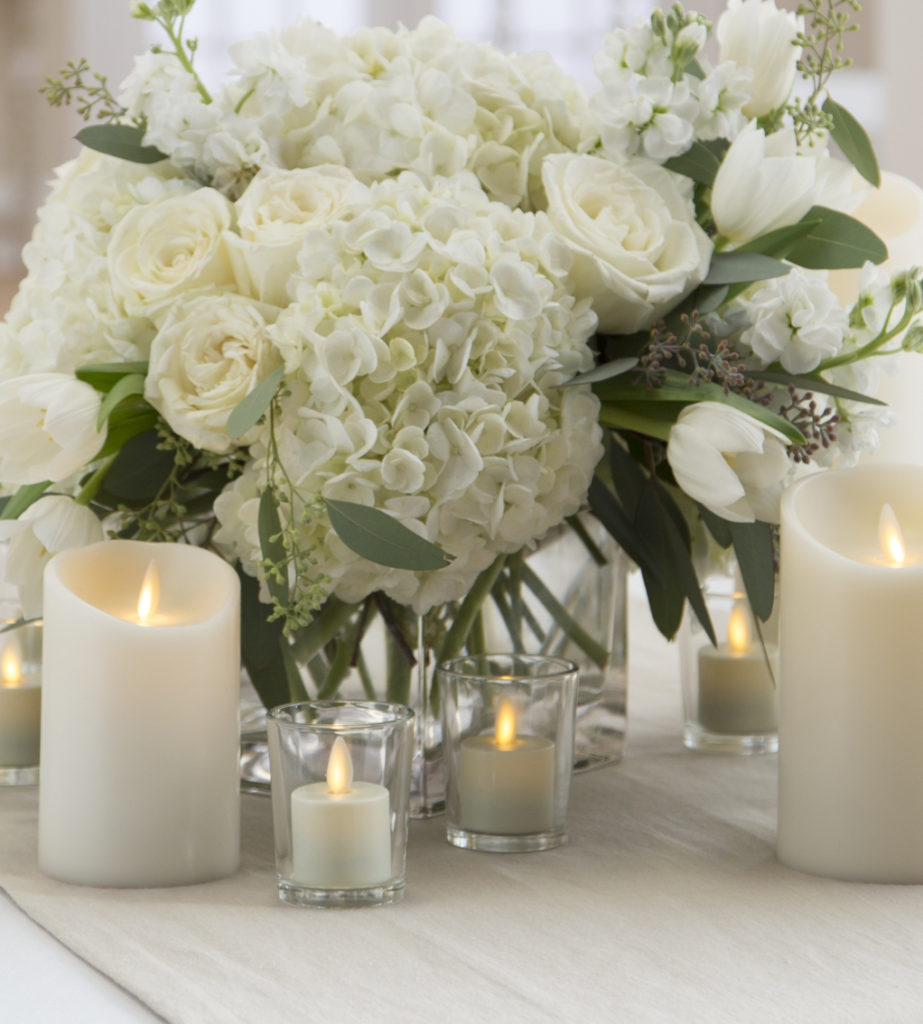 16 Stunning Floating Wedding Centerpiece Ideas: 10 Romantic Flameless Candle Wedding Centerpiece Ideas